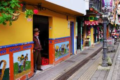 GUATAPE, ANTIOQUIA, COLOMBIA, AUGUST 08, 2018: Typically colourful buildings in Guatape. Los Zocalos - the lower parts of the facades of the houses, are usually stock photos