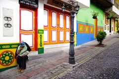 GUATAPE, ANTIOQUIA, COLOMBIA, AUGUST 08, 2018: Typically colourful buildings in Guatape. Los Zocalos - the lower parts of the facades of the houses, are usually stock photo
