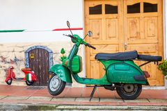 Green motorcycle at the colorful town of Guatape, Antioquia. GUATAPE, ANTIOQUIA - COLOMBIA, NOVEMBER 2017. Green motorcycle at the colorful town of Guatape Royalty Free Stock Photo