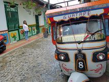 Guatape. Colombia street city south America  taxi Vespa Royalty Free Stock Image