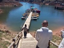 Guatape`s reservoir trip with friends. Friends on the big reservoir of Guatape, this is a tourist atraction Stock Photography