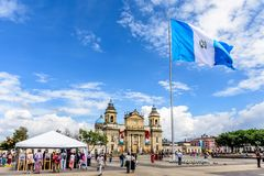 Cathedral of Guatemala City, Guatemala City. Guatemala City, Guatemala - September 5, 2018: Guatemalan flag waves outside Cathedral of Guatemala City royalty free stock photography