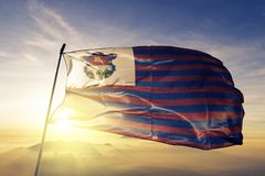 Guatemala Department of Guatemala flag textile cloth fabric waving on the top sunrise mist fog. Beautiful stock photo