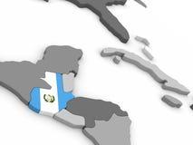 Guatemala en el globo con la bandera Fotos de archivo libres de regalías