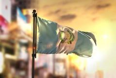 Guatemala Flag Against City Blurred Background At Sunrise Backli. Ght Sky Stock Images