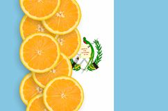 Guatemala flag and citrus fruit slices vertical row. Guatemala flag and vertical row of orange citrus fruit slices. Concept of growing as well as import and stock photos