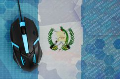 Guatemala flag and computer mouse. Digital threat, illegal actions on the Internet. Guatemala flag and modern backlit computer mouse. The concept of digital stock photos