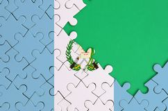 Guatemala flag is depicted on a completed jigsaw puzzle with free green copy space on the right side.  vector illustration