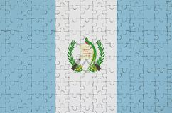 Guatemala flag is depicted on a folded puzzle royalty free illustration