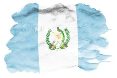 Guatemala flag is depicted in liquid watercolor style isolated on white background. Careless paint shading with image of national flag. Independence Day banner stock images