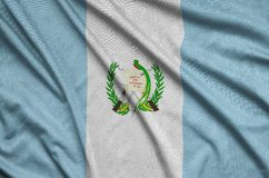 Guatemala flag is depicted on a sports cloth fabric with many folds. Sport team banner. Guatemala flag is depicted on a sports cloth fabric with many folds stock photos