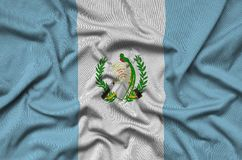 Guatemala flag is depicted on a sports cloth fabric with many folds. Sport team banner. Guatemala flag is depicted on a sports cloth fabric with many folds royalty free stock photo