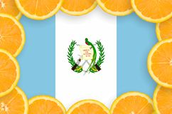 Guatemala flag in fresh citrus fruit slices frame. Guatemala flag in frame of orange citrus fruit slices. Concept of growing as well as import and export of vector illustration