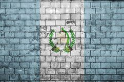 Guatemala flag is painted onto an old brick wall stock photography