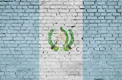 Guatemala flag is painted onto an old brick wall royalty free stock photography