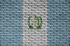 Guatemala flag is painted onto an old brick wall stock illustration