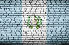 Guatemala flag is painted onto an old brick wall stock image