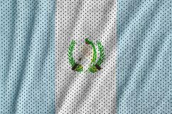 Guatemala flag printed on a polyester nylon sportswear mesh fabr. Ic with some folds royalty free stock photos