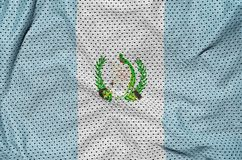 Guatemala flag printed on a polyester nylon sportswear mesh fabr. Ic with some folds stock image