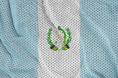 Guatemala flag printed on a polyester nylon sportswear mesh fabr. Ic with some folds stock images