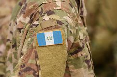 Guatemala flag on soldiers arm. Guatemala troops collage.  stock images