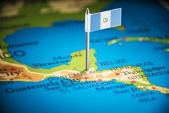 Guatemala marked with a flag on the map.  royalty free stock image
