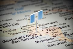 Guatemala marked with a flag on the map.  stock image