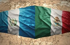 Guatemala and Mexico. Waving Guatemalan and Mexican flags on the of the political map of the world Stock Photo