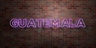GUATEMALA - muestra fluorescente del tubo de neón en el ladrillo - vista delantera - imagen común libre rendida 3D de los derecho Fotografía de archivo
