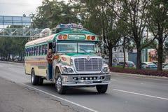 GUATEMALA - NOVEMBER 11, 2017: Guatemala City Street with Traffic. Daily View of Public Transport, like Colorful Chicken Bus, Taxi. Guatemala City Street with Royalty Free Stock Photography