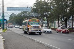 GUATEMALA - NOVEMBER 11, 2017: Guatemala City Street with Traffic. Daily View of Public Transport, like Colorful Chicken Bus, Taxi. Guatemala City Street with Stock Images