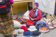 Guatemala Woman, Street Vendor, Travel. An old woman in Guatemala sells hats and baskets in a street market. Central or Latin America is a popular travel Royalty Free Stock Photography