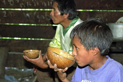 Free Guatemalan Father And Son Drinking Coconut Milk Royalty Free Stock Photos - 82817018