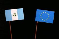 Guatemalan flag with European Union EU flag isolated on black. Background Stock Photography