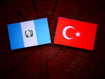 Guatemalan flag with Turkish flag on a tree stump isolated Stock Photos