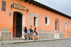 Guatemalan High School Students. High School girls with uniform at school entrance in Antigua, Guatemala Stock Photo