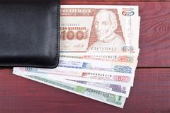 Guatemalan money in the black wallet Stock Images
