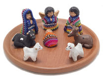 Guatemalan nativity scene. Christmas decoration made from clay and colorful fabric posed on plate stock photos