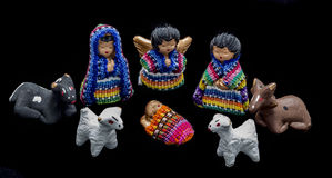 Guatemalan nativity scene. Traditional colorful handmade christmas figures made of fabric and clay stock photos