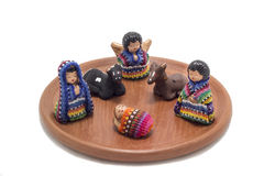 Guatemalan nativity scene. Traditional handmade christmas decoration made out of clay and colorful fabric stock images