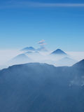 Guatemalan Volcanic Chain. A chain of Guatemalan volcanoes with an eruption Royalty Free Stock Photography