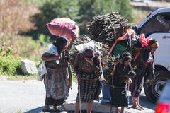 Guatemalan women and girls transporting supplies royalty free stock photography