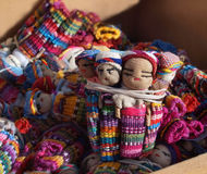 Guatemalan Worry Dolls. A shipment of colorful Guatemalan Worry Dolls in a cardboard box Stock Photography