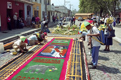 Guatemalans lay street carpet for Easter procession stock photography