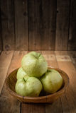 Guava in basket on wood table Royalty Free Stock Photos