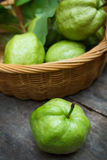 Guava. Fresh green guavas on old wood background Royalty Free Stock Photography