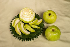Guava fruit carving on banana leaf Royalty Free Stock Images