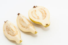 Guava fruit cut into three pieces. Riped guava fruit cut into three pieces arranged in a row Stock Photo