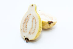 Guava fruit cut into two pieces. On white background Stock Photography