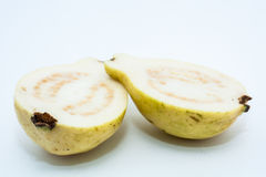 Guava fruit cut into two pieces. On white background Stock Images